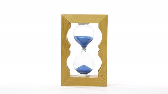 Thumbnail for Rotation. Hourglass Blue Sand Flowing on White Background