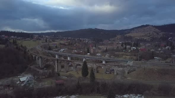 Flight Over the Village in the Carpathian Mountains