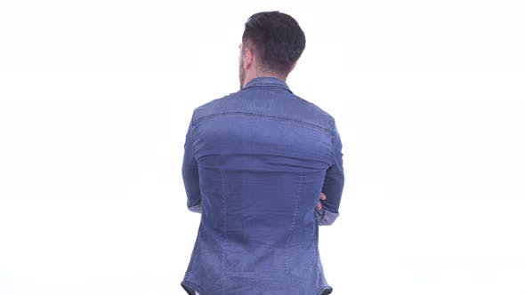Thumbnail for Rear View of Young Bearded Hipster Man Waiting and Thinking