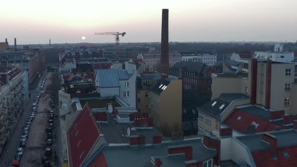 Thumbnail for AERIAL: Flight Over Beautiful Berlin Neighbourhood Rooftop Cityscape During Sunset