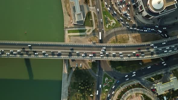 Thumbnail for Aerial Top Down View From Drone of Traffic Bridge City with Driving Car
