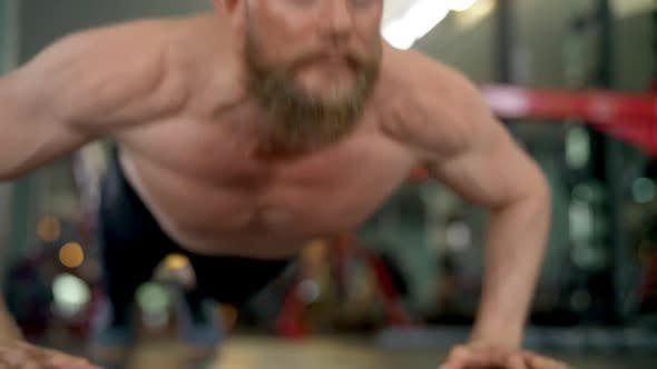 Thumbnail for Steady Shot of a Male Athlete Doing Clap Push Up Exercises in a Gym