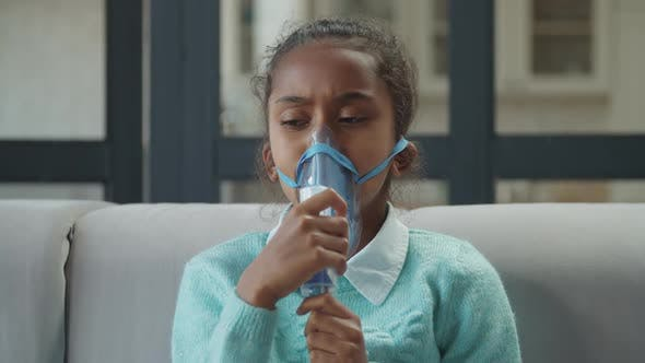 Thumbnail for Sick Girl Intense Breathing Through Nebulizer Mask