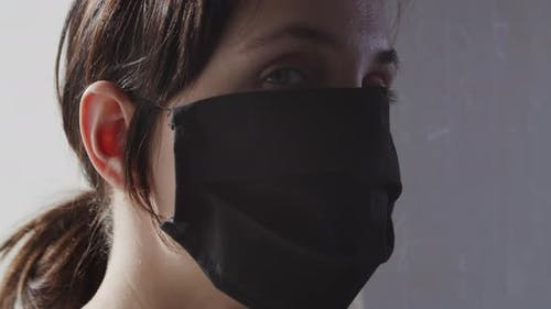 Woman In Black Face Mask