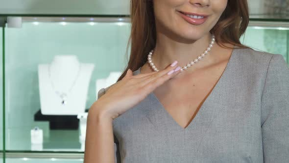 Thumbnail for Cropped Close Up of a Happy Woman Smiling Wearing Pearl Necklace