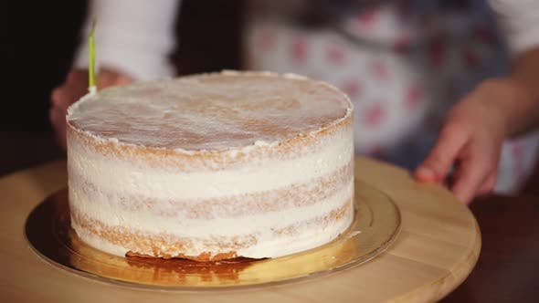 Thumbnail for Cook Woman Is Decorating Baked Layered Cake By Whipped Cream