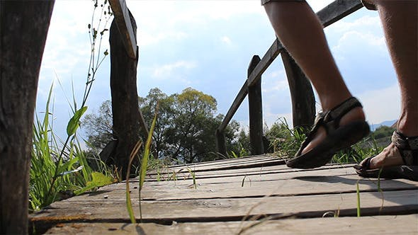 Thumbnail for Passing A Wooden Footbridge