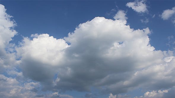Thumbnail for Puffy Clouds On Blue Sky Timelapse