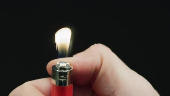 Thumbnail for Hand lighting a lighter