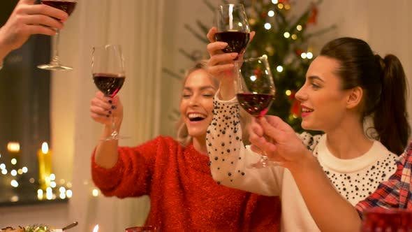 Cover Image for Happy Friends Drinking Red Wine at Christmas