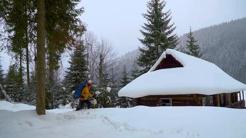 Tourist with a Backpack Travels in the Winter