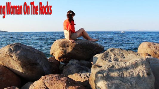 Thumbnail for Young Woman On The Rocks