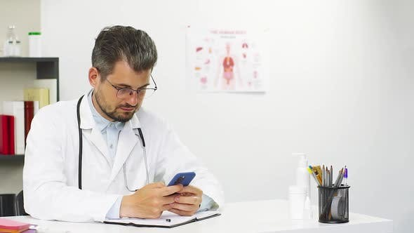 Thumbnail for Doctor Using Cell Phone at Hospital