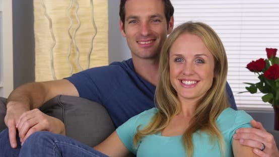Thumbnail for Happy couple sitting on couch together