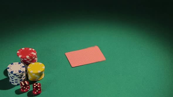 Dealer Working for Illegal Casino Dealing Cards to Players