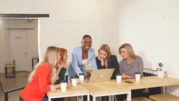 International Group of Happy Women Celebrating Success at Team Meeting