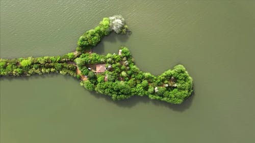 Aerial view of drone of a beautiful small island in the lake