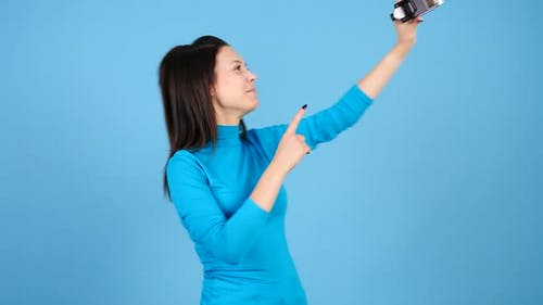 Woman Vlogger Talking To a Camcorder