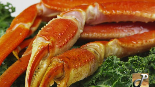 Thumbnail for Fresh Crab Legs With Lemons and Butter