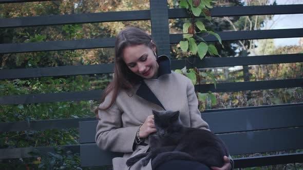 Thumbnail for Beautiful Woman Stroking Cat