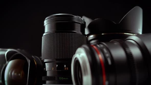 Thumbnail for Camera Lenses Spinning On Black Background