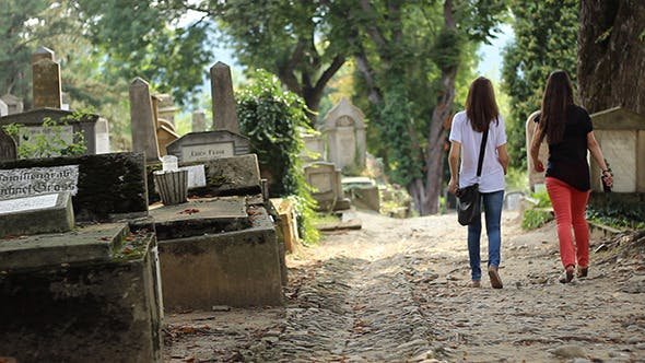 Thumbnail for Two Girls Walking in Cemetery