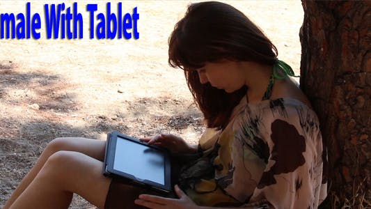 Thumbnail for Female With Tablet