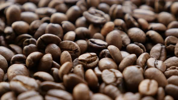 Thumbnail for Whole arabica coffee beans shallow DOF 4K 2160p UHD footage - Slow tilting over coffee beans arabica