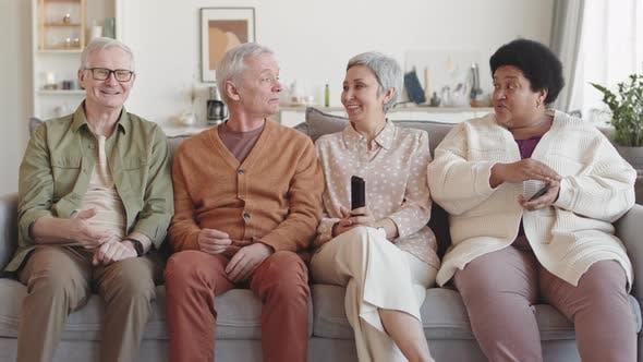 Seniors Watching TV Laughing