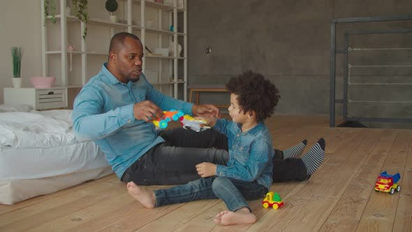 Thumbnail for Multiethnic Family with Kid Enjoying Playtime at Home