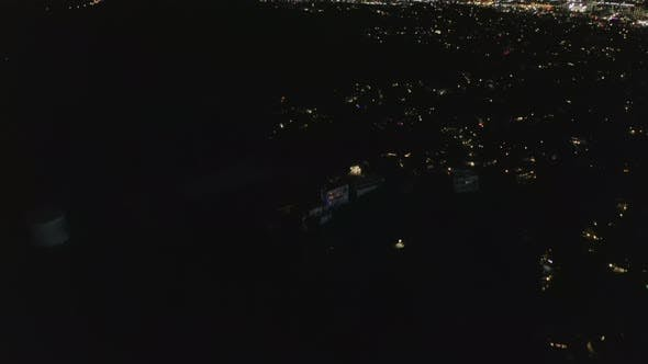 Thumbnail for Slow Tilt Move Over Hollywood Hills at Night Revealing Los Angeles City Lights