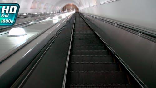 Descending on an Escalator
