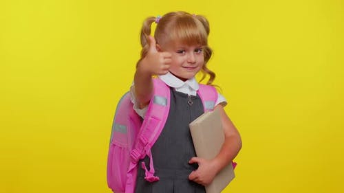 Kid Girl in School Uniform Showing Biceps and Looking Confident Feeling Power Strength for Study
