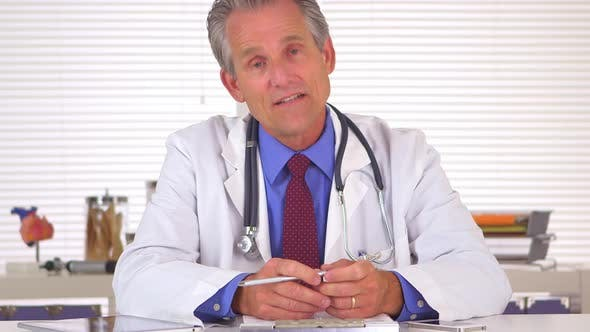 Thumbnail for Sincere doctor talking and looking at camera