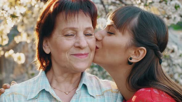 Thumbnail for Daughter Kissing Her Elderly Mother
