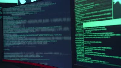 Code On Multiple Computer Screens, Cyber Attack