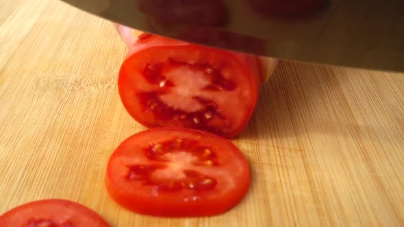 Thumbnail for The Cook Cuts the Tomato 4