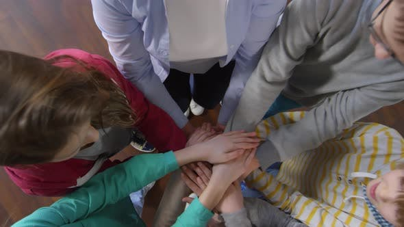 Cover Image for Six Kids Joining Hands Together with Teacher