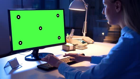 Cover Image for Businesswoman with Green Screen on Computer 80