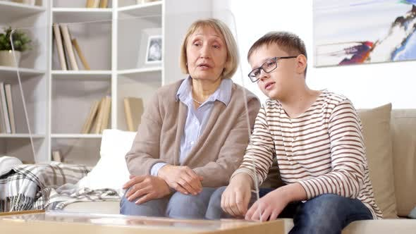 Thumbnail for Old Lady and Her Grandson Using AR Screen