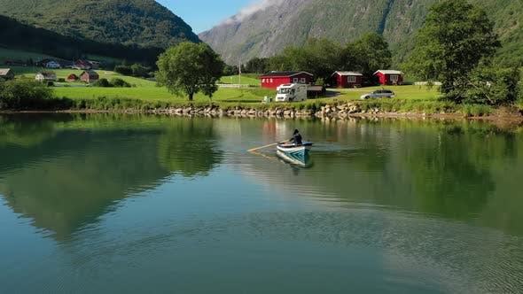 Thumbnail for Woman on the Boat Catches a Fish on Spinning in Norway