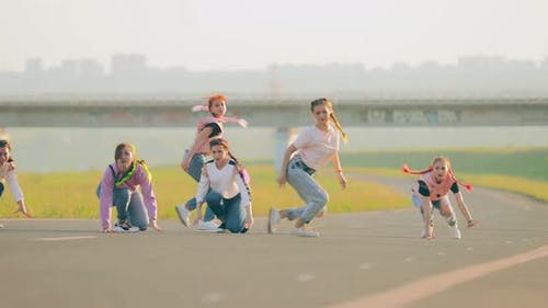 Young Attractive Dancers Dancing Hiphop on the Road