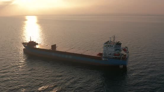 Thumbnail for Aerial View. Beatiful Sunset at the Sea. Huge Cargo Ship Floating in the Sea.