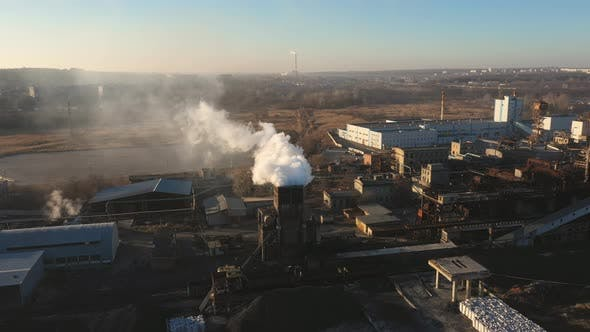 Thumbnail for Aerial Shot of Smoke Pouring From Chemical Factory Into Atmosphere