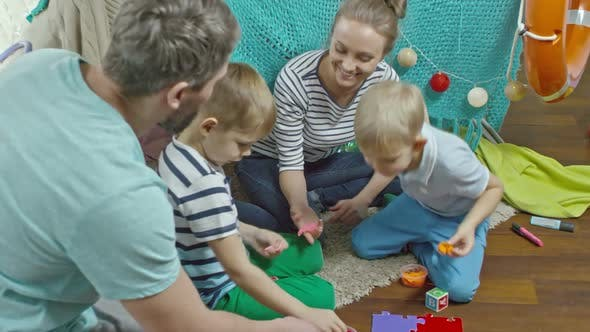 Thumbnail for Mom, Dad and Kids Playing with Colorful Clay