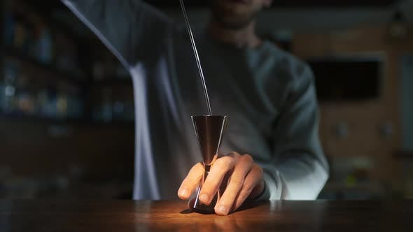 Thumbnail for Cinemagraph of Bartender Pours Whiskey To the Jigger in Slow Motion, Making of Alcohol Drink