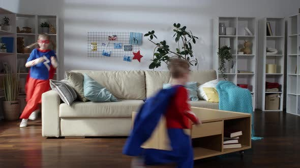 Thumbnail for Little Boy and Girl in Superhero Costumes Running and Having Fun