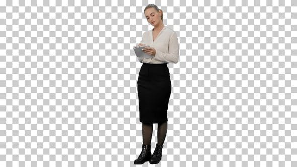 Attractive business woman makes some calculations, Alpha Channel