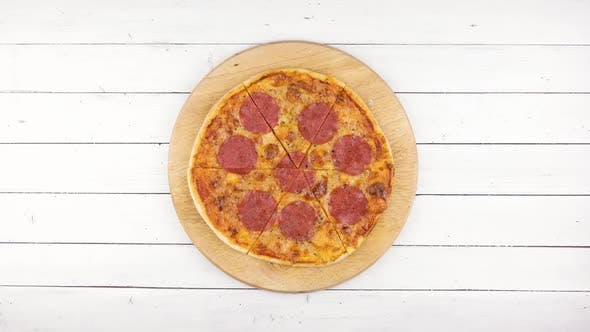 Thumbnail for Top View of Baking Pepperoni Pizza