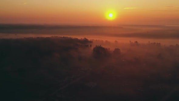Thumbnail for Flying Over the Morning Fog Spring Dawn